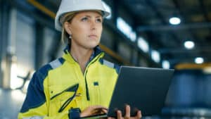 manufacturing leader looking at computer
