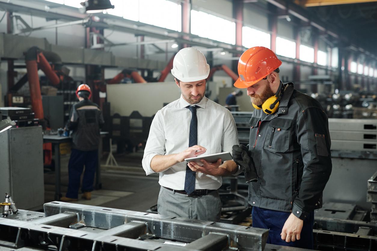 manufacturing leader talking to team member